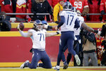Tennessee Titans' Dennis Kelly (71) celebrates his touchdown catch with quarterback Ryan Tannehill (17) during the first half of the NFL AFC Championship football game against the Kansas City Chiefs Sunday, Jan. 19, 2020, in Kansas City, MO. (AP Photo/Charlie Riedel)