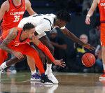 Clemson guard Marcquise Reed (2) and Georgia Tech forward Abdoulaye Gueye (34) reach for the ball during the first half of an NCAA college basketball Wednesday, Feb. 6, 2019, in Atlanta. (AP Photo/John Bazemore)