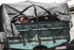 Civilians flee from Idlib toward the north to find safety inside Syria near the border with Turkey, on Saturday, Feb. 15, 2020. An offensive by President Bashar Assad's forces is aimed at recapturing remaining opposition-held areas in northwestern Syria. (AP Photo)