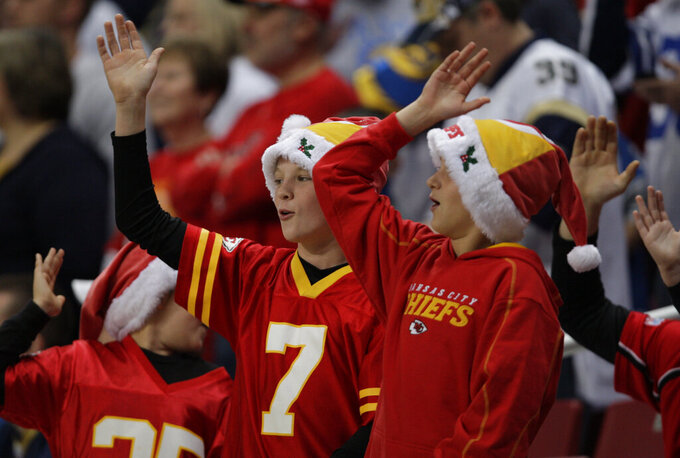 "FILE - In this Dec. 19, 2010, file photo, Kansas City Chiefs fans celebrate with the tomahawk chop during the fourth quarter of an NFL football game against the St. Louis Rams in St. Louis. While other sports teams using Native American nicknames and imagery have faced decades of protests and boycotts, the Chiefs have largely slid under the radar. Vincent Schilling, associate editor of Indian Country Today, said it's time for the Chiefs to face the music. ""When I see something like a tomahawk chop, which is derived from television and film portrayals, I find it incredibly offensive because it is an absolutely horrible stereotype of what a native person is."" (AP Photo/Tom Gannam, File)"