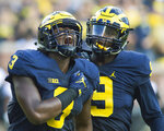 FILE - In this Sept. 17, 2016, file photo, Michigan defensive end Rashan Gary (3) celebrates a sack alongside linebacker Mike McCray (9) in the first half of an NCAA college football game against Colorado, in Ann Arbor, Mich. Gary is a possible pick in the 2019 NFL Draft. (AP Photo/Tony Ding, File)