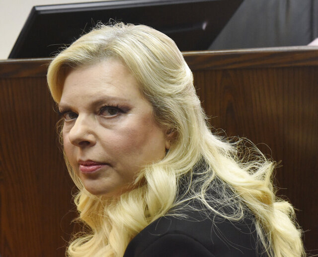 FILE - In this June 16, 2019 file photo, Sara Netanyahu, the wife of Israeli Prime Minister Benjamin Netanyahu, appears in the Magistrate Court, for a hearing on a plea deal over the misuse of state funds for meals at the premier's residence, in Jerusalem.  Israeli police said Sunday, May 31, 2020,  that it was investigating possible false testimony by two employees of the prime minister's official residence to favor Sara Netanyahu in a civil lawsuit against her.(Debbie Hill/Pool Photo via AP, File)