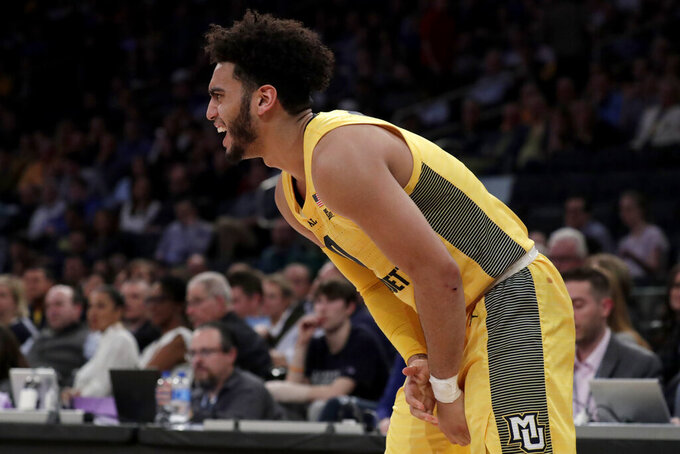 Marquette guard Markus Howard grabs at his wrist during the first half of an NCAA college basketball semifinal game against Seton Hall in the Big East men's tournament, Friday, March 15, 2019, in New York. (AP Photo/Julio Cortez)