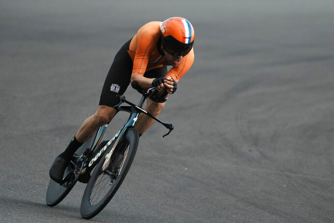 Tom Dumoulin of The Netherlands competes during the men's cycling individual time trial at the 2020 Summer Olympics, Wednesday, July 28, 2021, in Oyama, Japan. (AP Photo/Thibault Camus)