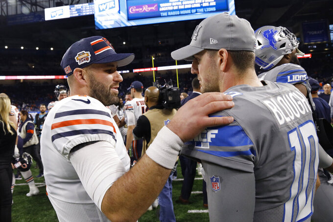 Chicago Bears quarterback Chase Daniel meets with Detroit Lions quarterback David Blough (10) after an NFL football game, Thursday, Nov. 28, 2019, in Detroit. (AP Photo/Rick Osentoski)