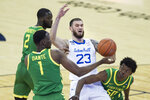 Oregon defense players, from left to right, Eugene Omoruyi, N'Faly Dante and Eric Williams Jr. prevent Seton Hall's Sandro Mamukelashvili (23) from shooting during the first half of an NCAA college basketball game in Omaha, Neb., Friday, Dec. 4, 2020. (AP Photo/Kayla Wolf)
