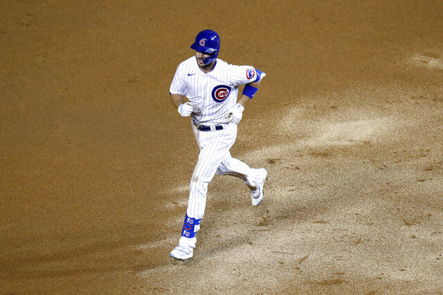 Chicago Cubs' Kris Bryant rounds the bases after hitting a home run during the seventh inning of a baseball game against the Kansas City Royals Monday, Aug. 3, 2020, in Chicago. (AP Photo/Charles Rex Arbogast)