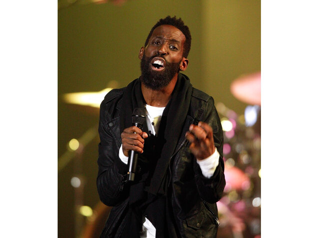 "FILE - This Oct. 11, 2016 file photo shows gospel singer Tye Tribbet performing at the 47th Annual GMA Dove Awards in Nashville, Tenn. Tribbett released the new song ""We Gon' Be Alright"" on Friday. The new track interpolates part of Kendrick Lamar's anthemic 2015 song, which was co-produced by Pharrell and won two Grammy Awards. (Photo by Wade Payne/Invision/AP, File)"