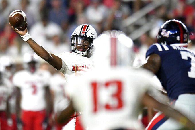 Austin Peay quarterback Draylen Ellis passes the ball against Mississippi during an NCAA college football game in Oxford, Miss., Saturday, Sept. 11, 2021. (AP Photo/Bruce Newman)