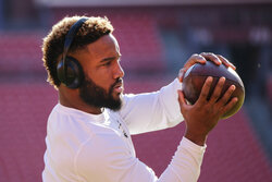 Philadelphia Eagles running back Boston Scott warming up before the start of the an NFL football game against the Washington Redskins, Sunday, Dec. 15, 2019, in Landover, Md. (AP Photo/Mark Tenally)