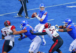 Boise State quarterback Brett Rypien (4) looks down field as he comes under pressure from the San Diego State defense in the first half of an NCAA college football game, Saturday, Oct. 6, 2018, in Boise, Idaho. (AP Photo/Steve Conner)