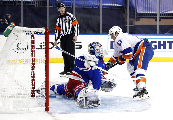 New York Rangers goalie Igor Shesterkin makes a save against New York Islanders' Mathew Barzal during the third period of an NHL hockey game Thursday, Jan. 14, 2021, in New York. (Bruce Bennett/Pool Photo via AP)
