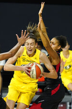 Seattle Storm forward Breanna Stewart (30) slips around Las Vegas Aces forward Cierra Burdick (11) during the second half of Game 3 of basketball's WNBA Finals Tuesday, Oct. 6, 2020, in Bradenton, Fla. (AP Photo/Chris O'Meara)