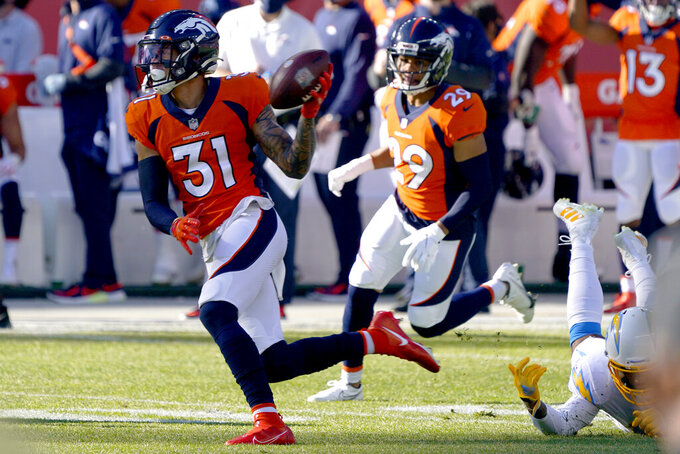 Denver Broncos free safety Justin Simmons (31) runs back an interception against the Los Angeles Chargers during the first half of an NFL football game, Sunday, Nov. 1, 2020, in Denver. (AP Photo/David Zalubowski)