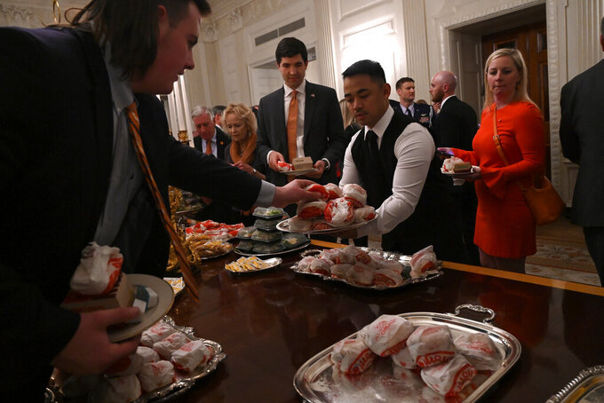 Trump's burger-fest brings roasting from late-night TV hosts