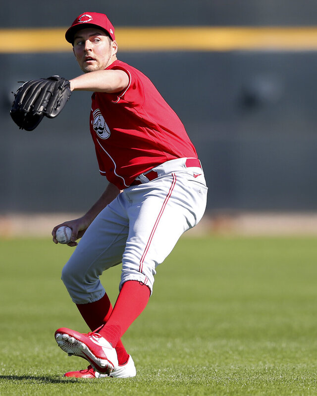 Cincinnati Reds starting pitcher Trevor Bauer (27)  throws long tosses, Saturday, Feb. 15, 2020, at the Reds spring training baseball facility in Goodyear, Ari.z. (Kareem Elgazzar/The Cincinnati Enquirer via AP)