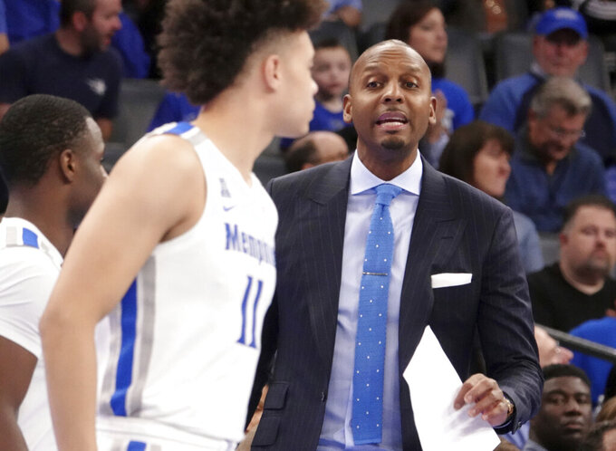 Memphis' head coach Penny Hardaway calls to his players in the first half of an NCAA college basketball game against New Orleans Saturday, Dec. 28, 2019, in Memphis, Tenn. (AP Photo/Karen Pulfer Focht)