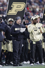 Purdue head coach Jeff Brohm calls a play from the sideline against Wisconsin during the first half of an NCAA college football game in West Lafayette, Ind., Saturday, Nov. 17, 2018. (AP Photo/Michael Conroy)