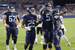 Tennessee Titans wide receiver Cameron Batson, right, is congratulated by Jordan Roos (57) after Batson scored a touchdown against the Chicago Bears in the second half of a preseason NFL football game Saturday, Aug. 28, 2021, in Nashville, Tenn. (AP Photo/Mark Zaleski)