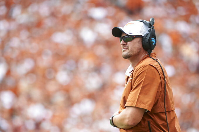 FILE - In this Oct. 6, 2018, file photo, Texas coach Tom Herman watches during the second half of the team's NCAA college football game against Oklahoma at the Cotton Bowl in Dallas. Herman's team is looking to bounce back from a loss at Oklahoma State that ended its six-game winning streak, as it prepares to play West Virginia this week. (AP Photo/Cooper Neill, File)