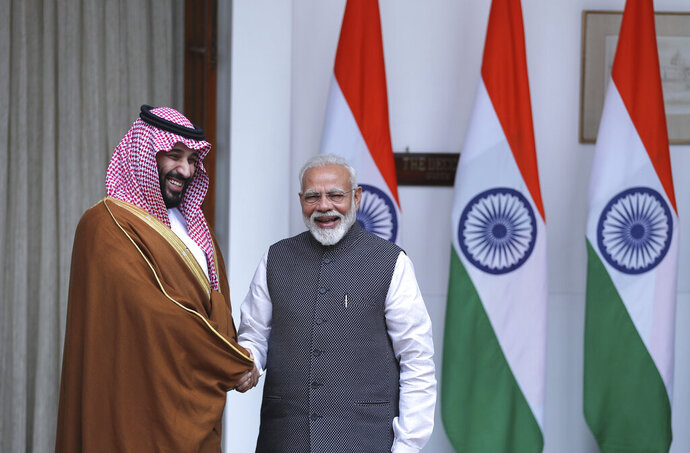 Indian Prime Minister Narendra Modi, right, shakes hand with Saudi Crown Prince Mohammed bin Salman before the start of their meeting in New Delhi, India, Wednesday, Feb. 20, 2019. Saudi Crown Prince Mohammed bin Salman on Wednesday said his visit to India will improve centuries-old ties, which he said are