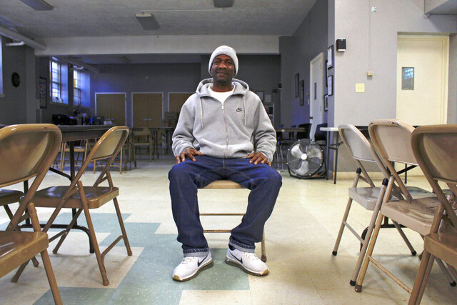 In this Dec. 11, 2019, photo, Quentin Blackburn poses for a photo in Milwaukee. Blackburn is a felon who didn't realize he could vote when his probation was finished.