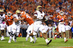 Boston College's AJ Dillon, center, runs in for a touchdown during the first half of an NCAA college football game against Clemson, Saturday, Oct. 26, 2019, in Clemson, S.C. (AP Photo/Richard Shiro)
