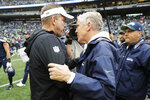 New Orleans Saints head coach Sean Payton, left, talks with Seattle Seahawks head coach Pete Carroll, right, after an NFL football game, Sunday, Sept. 22, 2019, in Seattle. (AP Photo/Ted S. Warren)