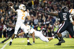 Tennessee quarterback Jarrett Guarantano (2) prepares to throw a touchdown pass against South Carolina defensive lineman Keir Thomas (5) during the first half of an NCAA college football game Saturday, Oct. 27, 2018, in Columbia, S.C. (AP Photo/Sean Rayford)