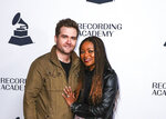 FILE - In this Tuesday, Jan. 7, 2020, file photo, Sam Ashworth, left, and Ruby Amanfu arrive at the 62nd Annual GRAMMY Awards - Nashville Nominee Party at the Hutton Hotel, in Nashville, Tenn. Nashville songwriters are showing up at the Grammys this year, but not just in the country music categories. Nashville songwriting couple Amanfu and Ashworth are nominated in top all-genre categories for working with Grammy-winning R&B artist H.E.R. Country songwriting put Nashville on the map, but Ashworth tells The Associated Press that a lot of other music is being written there as well. (Photo by Al Wagner/Invision/AP, File)