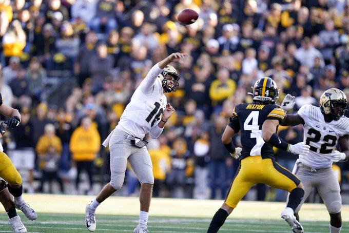 Purdue quarterback Aidan O'Connell (16) throws a pass during the second half of an NCAA college football game against Iowa, Saturday, Oct. 16, 2021, in Iowa City, Iowa. Purdue won 24-7. (AP Photo/Charlie Neibergall)