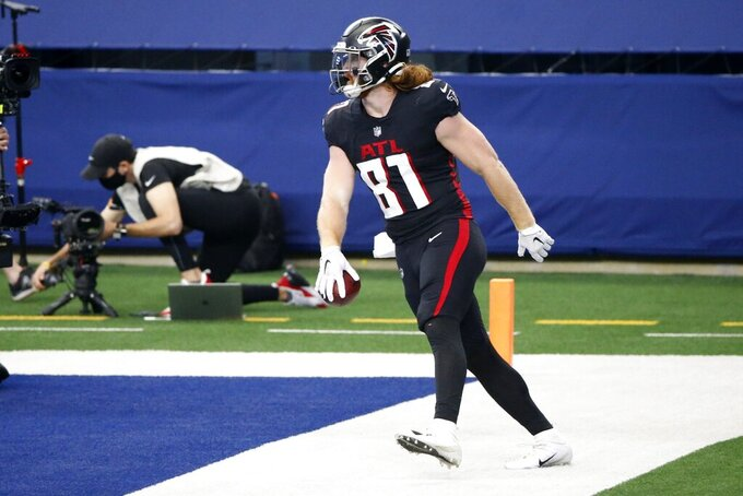 Atlanta Falcons tight end Hayden Hurst (81) celebrates after catching a pass for a touchdown in the first half of an NFL football game against the Dallas Cowboys in Arlington, Texas, Sunday, Sept. 20, 2020. (AP Photo/Ron Jenkins)