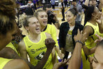 Seattle Storm's Sami Whitcomb, left, lets out a yell in the team huddle after the Storm defeated the Las Vegas Aces 69-66 in a WNBA basketball game Friday, July 19, 2019, in Seattle. (AP Photo/Elaine Thompson)