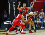 Utah guard Sedrick Barefield (2) attempts to steal the ball from Southern California forward Nick Rakocevic, right, as Utah forward Novak Topalovic (13) defends during the second half of an NCAA college basketball game Thursday, March 7, 2019, in Salt Lake City. (AP Photo/Rick Bowmer)