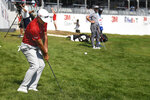 Gary Woodland chips onto the 18th green during the third round of the 3M Open golf tournament in Blaine, Minn., Saturday, July 24, 2021. (AP Photo/Craig Lassig)