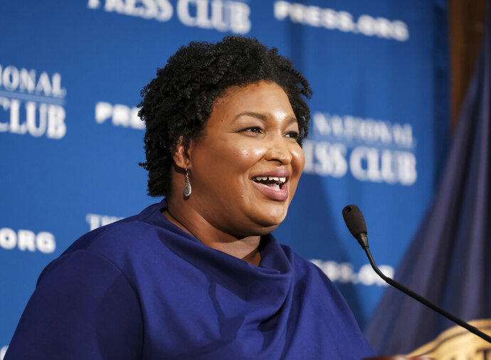 In this Nov. 15, 2019, photo, former Georgia House Democratic Leader Stacey Abrams, speaks at the National Press Club in Washington. Growth and urbanization has made Georgia's population younger, less native to the state and less white. That, combined with President Donald Trump's struggles among previously GOP-leaning white college graduates, has put Georgia on the cusp of presidential battleground status. The question is how close. (AP Photo/Michael A. McCoy)