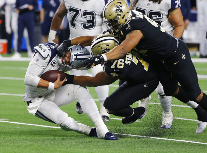 FILE - In this Thursday, Nov. 29, 2018, file photo, Dallas Cowboys quarterback Dak Prescott (4) is sacked by New Orleans Saints defensive tackle Taylor Stallworth (76) during the second half of an NFL football game, in Arlington, Texas. The Saints defense will take on one of the NFL's best offenses in the NFC title game against the Los Angeles Rams. (AP Photo/Michael Ainsworth, File)