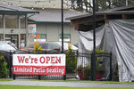 A sign at the El Sarape restaurant advertises outdoor seating, Tuesday, Jan. 5, 2021, in Olympia, Wash. Indoor dining is currently prohibited in the state, and Washington Gov. Jay Inslee was scheduled to give an update on ongoing state efforts to slow the spread of COVID-19 at a news conference Tuesday afternoon. (AP Photo/Ted S. Warren)