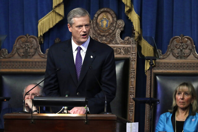 Massachusetts Gov. Charlie Baker, center, delivers his state of the state address in the House Chamber as Speaker of the House Robert DeLeo, behind left, and Senate President Karen Spilka, right, look on, Tuesday, Jan. 21, 2020, at the Statehouse in Boston. (AP Photo/Steven Senne)