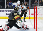 Vancouver Canucks center Elias Pettersson (40) shoots on Vegas Golden Knights goaltender Marc-Andre Fleury (29) during the third period of an NHL hockey game, Sunday, Dec. 15, 2019, in Las Vegas. (AP Photo/John Locher)