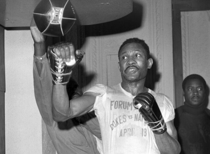 """FILE - In this April 1969 file photo, welterweight boxer Curtis Cokes trains for his fight against Joe Napoles in Los Angeles. Cokes, the Hall of Fame welterweight who became Dallas' first world champion in 1966, has died. He was 82. Erwin """"Sparky"""" Sparks, Cokes' partner at the Home of Champions gym, told The Dallas Morning News that Cokes died Friday, May 29, 2020, after a week in hospice. (AP Photo, File)"""