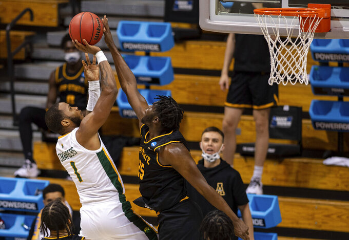 Appalachian State forward James Lewis Jr. (25) blocks a shot by Norfolk State forward Nyzaiah Chambers (1) during the first half of a First Four game in the NCAA men's college basketball tournament, Thursday, March 18, 2021, in Bloomington, Ind. (AP Photo/Doug McSchooler)