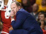 Wisconsin coach Greg Gard watches his team play Minnesota during the first half of an NCAA college basketball game Wednesday, Feb. 5, 2020, in Minneapolis. (AP Photo/Hannah Foslien)