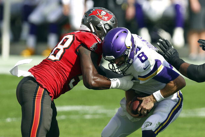 Tampa Bay Buccaneers outside linebacker Shaquil Barrett (58) sacks Minnesota Vikings quarterback Kirk Cousins (8) during the first half of an NFL football game Sunday, Dec. 13, 2020, in Tampa, Fla. (AP Photo/Mark LoMoglio)
