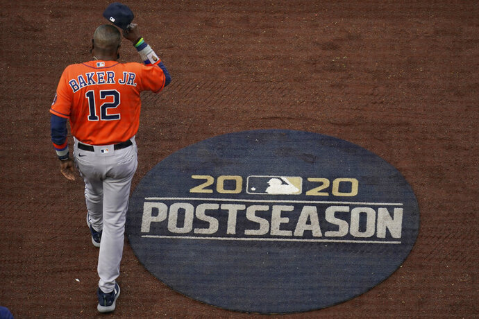 Houston Astros manager Dusty Baker Jr. walks out to the infield for the national anthem before Game 7 of a baseball American League Championship Series between the Houston Astros and the Tampa Bay Rays, Saturday, Oct. 17, 2020, in San Diego. (AP Photo/Gregory Bull)
