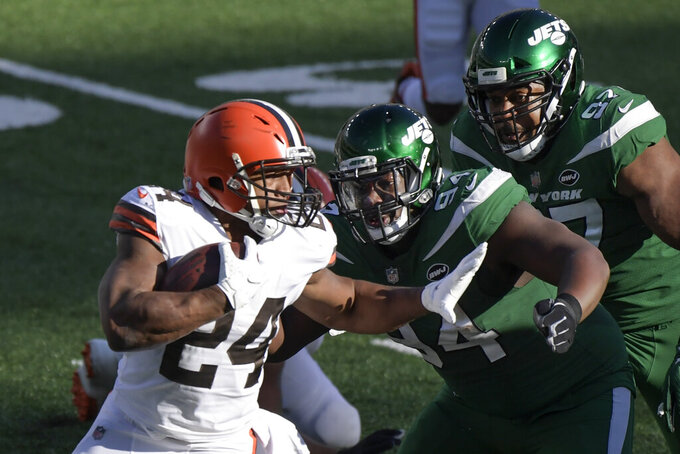 New York Jets defensive tackle Foley Fatukasi (94) and Nathan Shepherd (97) tackle Cleveland Browns' Nick Chubb (24) during the first half of an NFL football game Sunday, Dec. 27, 2020, in East Rutherford, N.J. (AP Photo/Bill Kostroun)