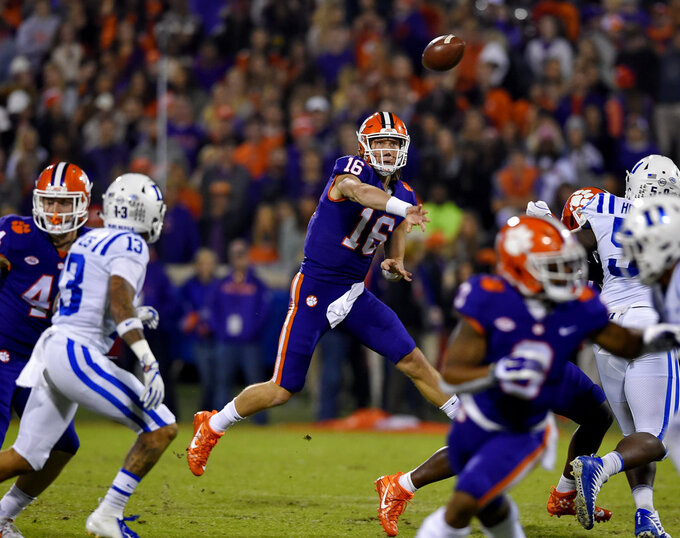 Clemson quarterback Trevor Lawrence throws a pass under pressure during the first half of an NCAA college football game against Duke on Saturday, Nov. 17, 2018, in Clemson, S.C. (AP Photo/Richard Shiro)
