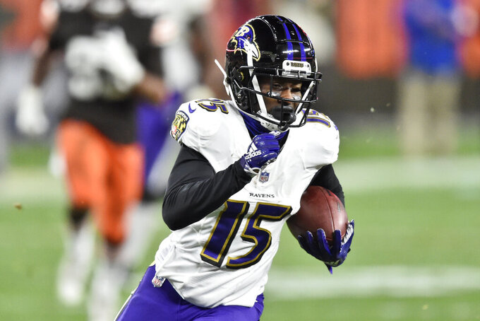 Baltimore Ravens wide receiver Marquise Brown (15) runs after catching a pass for a 44-yard touchdown during the second half of an NFL football game against the Cleveland Browns, Monday, Dec. 14, 2020, in Cleveland. The Ravens won 47-42. (AP Photo/David Richard)