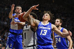 Butler forward Jordan Tucker (1) gets tied up with Creighton forward Christian Bishop (13) and guard Marcus Zegarowski (11) in the first half of an NCAA college basketball game in Indianapolis, Saturday, Jan. 4, 2020. (AP Photo/Michael Conroy)