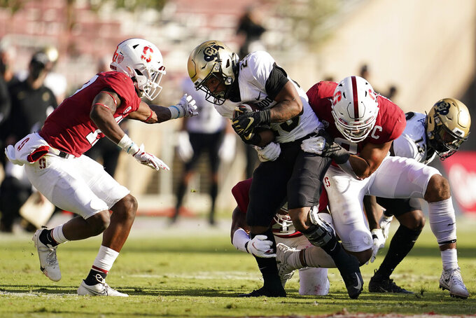 Colorado running back Jarek Broussard, center, runs against Stanford during the second half of an NCAA college football game in Stanford, Calif., Saturday, Nov. 14, 2020. (AP Photo/Jeff Chiu)